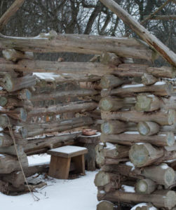 log lean-to with copper pan