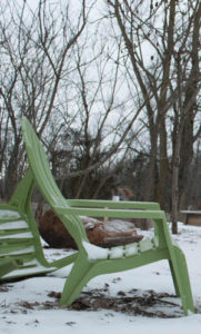 green lawn chair in snow